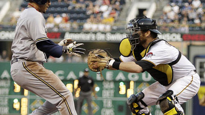 Pirates catcher Ryan Doumit waits to put the tag on  Brewers second baseman Felipe Lopez who was going on contact on a ground ball by Brewers outfielder Ryan Braun in the fifth inning.