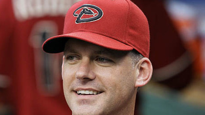 Diamondbacks manager A.J. Hinch smiles during last night's game.