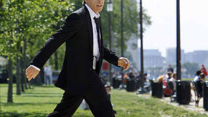 Actor Ben Stiller strides across the National Mall while filming a scene for the movie, &quot;Night at the Museum: Battle of the Smithsonian,&quot; in Washington.