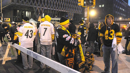 Steelers fans wait in the early morning hours for the prime spots near the grandstand at the Boulevard of the Allies at Stanwix Street.