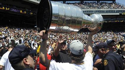The PNC Park crowd erupts as Sidney Crosby hoists the Stanley Cup before the game against the Tigers yesterday, Many members of the NHL champion Penguins attended the game.