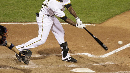 Pirates outfielder Andrew McCutchen hits a walk-off single in the ninth inning of last night's 3-2 win against the Indians.