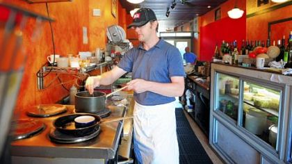 Owner Paul Krawiec works in the tight quarters of the kitchen at Cafe du Jour.