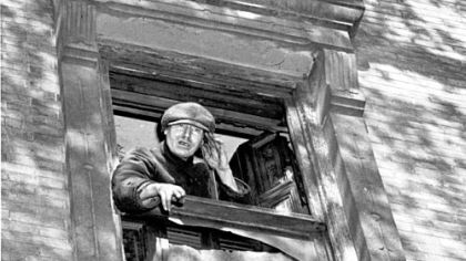 "Langley Collyer, the Harlem recluse, makes a public appearance in September 1942, from one of the dingy upper windows of the ramshackle New York brownstone where he and his brother, Homer, lived. He was loudly inviting assistance against ""invaders,"" the clean-up squads sent to tidy up the property."