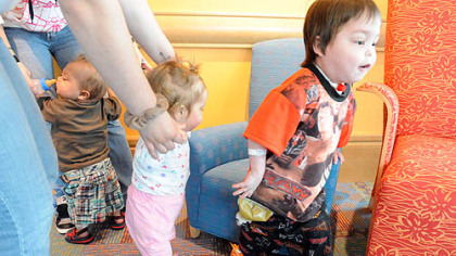 Transplant patient Oliver Wilhelm III, right, 5, of Kingwood, W.Va., explores the new environment at the Children's Hospital in Lawrenceville yesterday with his playmates, 21-month-old Bentley Brands of Tyler, Texas, left, and 13-month-old Abigail Dovolos of Buffalo, N.Y.