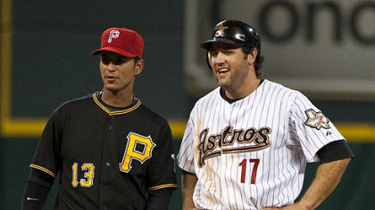 Astros first baseman Lance Berkman jokes with Pirates shortstop Ronny Cedeno after hitting a double during the third inning.