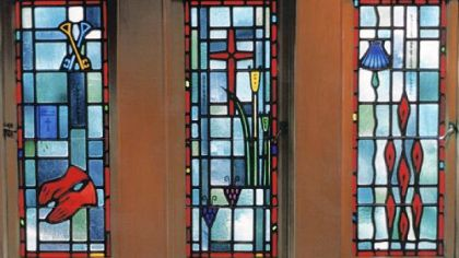 Windows created by Henry Hunt Studios  for a chapel in the bishop's mansion. The symbols in the windows describe the duties of a bishop, and were commissioned by Bishop John Dearden.