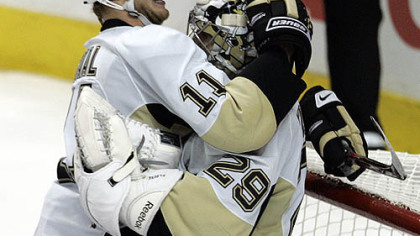 Jordan Staal bear hugs Marc-Andre Fleury in the moments after the Penguins completed their remarkable comeback to beat the Flyers yesterday at Wachovia Center in Philadelphia and advance to the second round of the NHL playoffs.