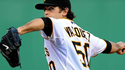 Pirates Virgil Vasquez delivers at pitch against the Brewers.