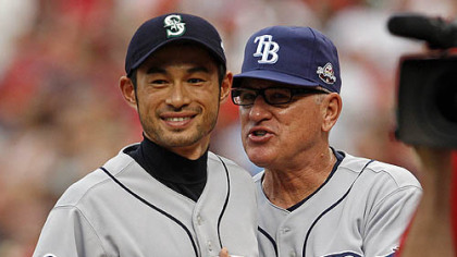 Rays manager Joe Maddon chats with Mariners outfielder Ichiro Suzuki before the game.