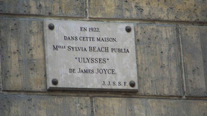 "This plaque on a building at 12 rue de L'Odeon, Paris, acknowledges the initial publication of James Joyce's ""Ulysses"" by the Shakespeare and Company Bookstore owned by American Sylvia Beach. The publisher was Harriet Shaw Weaver."
