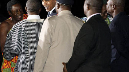 President Barack Obama, third from left, is greeted in Accra, Ghana, after his arrival this evening.