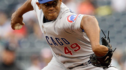 Cubs closer Carlos Marmol throws in the ninth inning.
