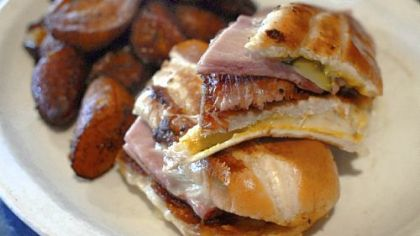 A pressed Cuban sandwich, backstopped with fried plaintains at the Starliner Diner in Hilliard, Ohio. The bread is baked daily and the pressed sandwich offers the traditional fillings of ham, roast pork, Swiss cheese, mustard and pickle.