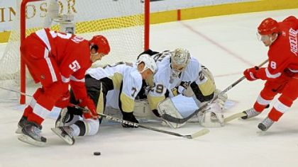 Detroit's Jonathan Ericsson, left, battles in front of the Penguins' net Saturday -- three days after having an appendectomy.