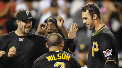 The Pirates mob outfielder Garrett Jones at home after his walk-off home run in the 14th inning.