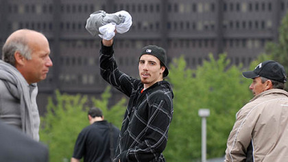 Penguin goalie Marc-Andre Fleury waves to fans outside of Mellon Arena as he leaves after practice yesterday.