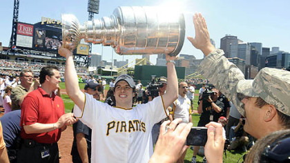Sidney Crosby hoists the Stanley Cup at PNC Park yesterday.