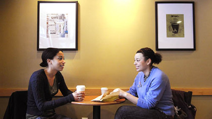 Roommates Heather Curry, left, and Erica Stewart chat between college classes at Starbucks in Market Square.