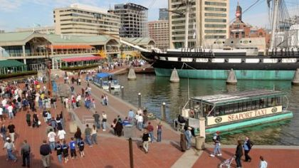 A water taxi docks at Baltimore's Inner Harbor, a popular tourist destination in the city.