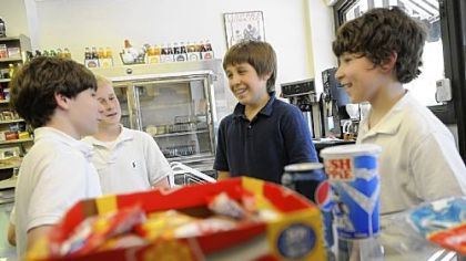 From left, Luke Farrell, Tommy Watson, Liam Fontes and Alex Stockman -- all seventh-graders at nearby St. Bede School -- stop in at the Frick Park Market several times a week to buy candy.
