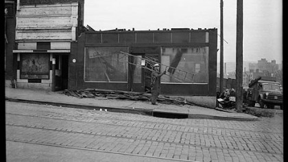 Exterior view of Crystal Barber Shop and Billiard Parlor being razed, Wylie Avenue, Hill