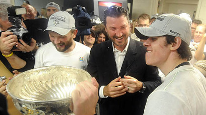 Dripping with champagne, from left, Sergei Gonchar, Mario Lemieux and Evgeni Malkin celebrate with the Stanley Cup after defeating the Red Wings in seven games Friday. Normally hands off, Lemieux provided the Penguins players and coaches with uplifting support throughout the long two months of the Stanley Cup playoffs.
