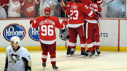 Red Wings players converge on Valtteri Filppula to celebrate his go-ahead goal in the second period last night.