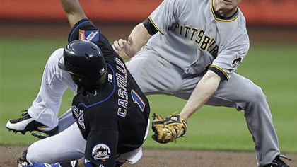 The Mets' Luis Castillo steals second base ahead of the tag from Pirates' shortstop Brian Bixler in the first inning of last night's game at Citi Field in New York.