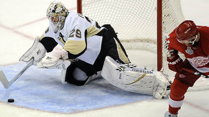 Goaltender Marc-Andre Fleury makes a save in front of Red Wings Dan Cleary in the first period of Game 7 of the Stanley Cup final in Detroit.