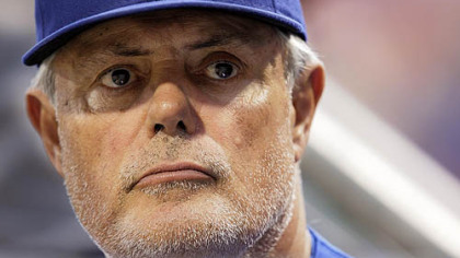Cubs manager Lou Piniella stands in the dugout during last night's game.