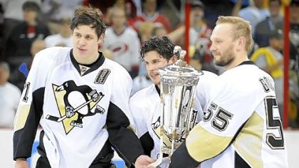 From left, Evgeni Malkin, Sidney Crosby and Sergei Gonchar pose with the Prince of Wales Trophy after beating the Carolina Hurricanes to win the Eastern Conference title last night.