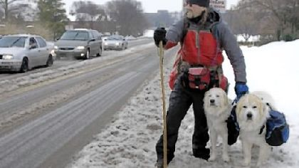 Luke Robinson of Austin, Texas, on a snow-covered road this winter as he walked from Austin toward Boston.