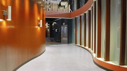 "A corridor on the ""Three Rivers"" set evokes the flow of a river in its bed."
