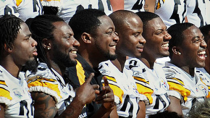Steelers coach Mike Tomlin, third from left, poses with his players for the team photo at the end of media day Tuesday at Raymond James Stadium in Tampa, Fla.