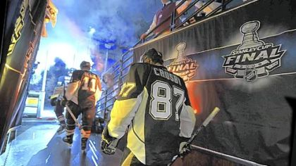 Penguins captain Sidney Crosby and teammates make their way to the ice.