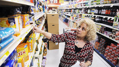 Susan Samtur checks a list of items she needs at a Shop 'n Save in Lawrenceville. Ms. Samtur has been a 'coupon queen' since the 1970s.