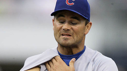Cubs pitcher Ted Lilly uses his sleeve to wipe his face on the mound during the third inning of last night's game.