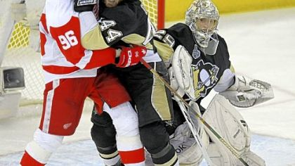 Brooks Orpik battles Detroit's Tomas Holmstrom in front of Marc-Andre Fleury. Fleury registered 25 saves in helping send the series back to Detroit for Game 7 Friday night at Joe Louis Arena.