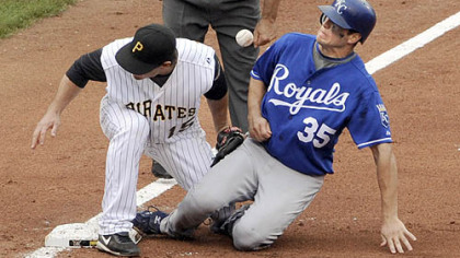Andy LaRoche can't come up with the ball as the Royals' Mitch Maier slides safely into third base in the fifth inning.