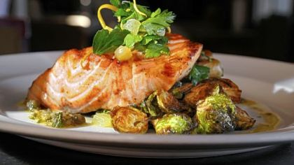 On the menu at Eleven:  Scottish salmon, with fingerling potatoes, black pepper bacon, brussels sprouts and caper vinaigrette.