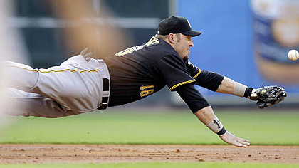 Pittsburgh third baseman Eric Hinske dives for a ball hit by Houston Astros' Hunter Pence during the first inning the game yesterday.