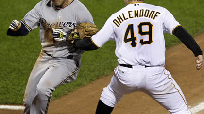 Pirates pitcher Ross Ohlendorf tags out Brewers second baseman Felipe Lopez to end a fifth-inning rundown between third and home.