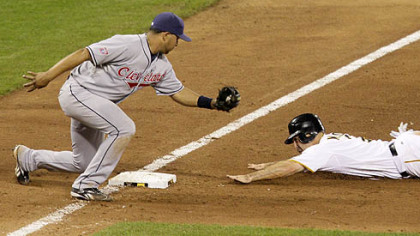 Pirates shortstop Jack Wilson steals third base in the ninth inning as Indians third baseman Jhonny Peralta attempts a tag.