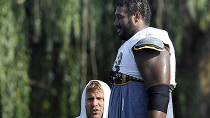 Ben talks with Max Starks, who fell on him during pass drills near the end of practice.
