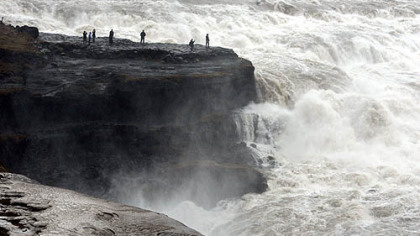 Tourists visit the Gullfoss waterfall in the canyon of the Hvita river in southwest Iceland.