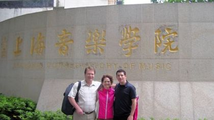 Pittsburgh Symphony Orchestra musicians William Caballeo (L), Nancy Goeres and Michael Rusinek, pose outside the Shanghai Conservatory in May before they give master classes during the PSO tour to Asia.