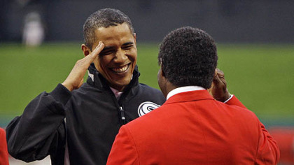 President Barack Obama salutes former cardinals outfielder Lou Brock before the first inning.