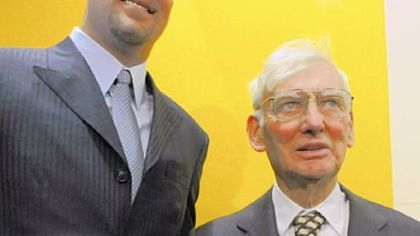 Quarterback Ben Roethlisberger smiles with Dan Rooney last March after signing a new $102 million contract.