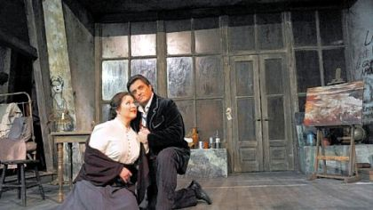 "Pamela Armstrong, as Mimi, and Frank Lopardo, as Rodolfo, rehearse for the Pittsburgh Opera's production of ""La Boheme."""